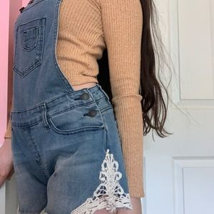 Overall shorts with lace details at the bottom